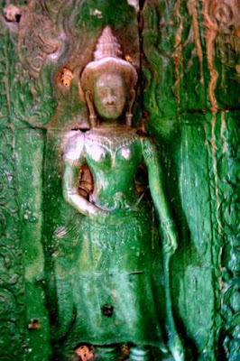 Nice decolletage... Image of a Khmer apsara, garbed in skin-tight algae, from a temple complex near Siem Reap, Cambodia.