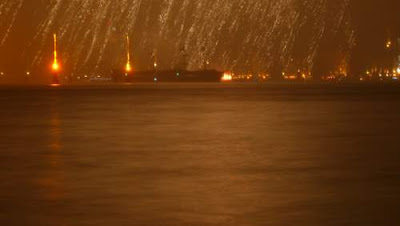 Image of incendiary particles showering down upon a ship in the Grand Canal, Venice.