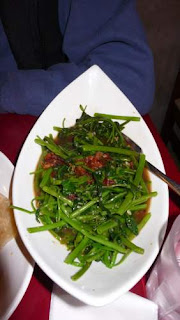 Image of stir-fried vegetables (a morning glory variety, allowing savoury revenge for gardeners) with a fermented shrimp paste at Pasar restaurant in Hong Kong.