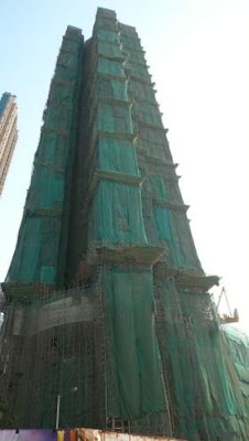 Another image of bamboo scaffolding on a residential high rise/skyscraper in Hong Kong.