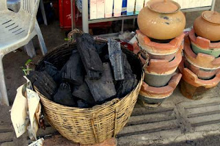 Image of carbon for sale at the side of the road for housewives to power their stoves and feed their families