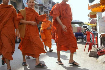 Image of young Buddhist monks walking to school at the start of the day in Phnom Penh, Cambodia.