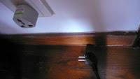 Image of a plug and a wall socket.