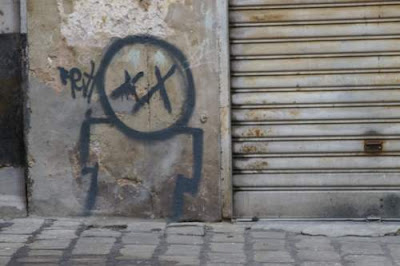 Graffiti image of a dead citizen from the old town centre of Genoa, Italy.