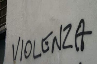 Graffiti image of a spray-painted word, violence, from the old town centre of Genoa, Italy.