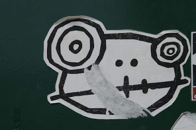 Graffiti image of a sticker of an alien goat from the Old Town centre of Genoa, Italy.