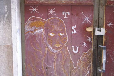 Graffiti image of an astral projection, hippy girl from the old town centre of Genoa, Italy.