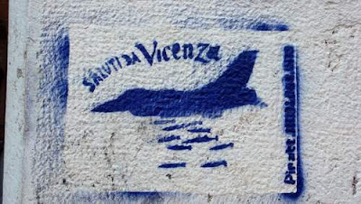 Graffiti image of plane dropping bombs found in Venice, Italy near the Arsenale.