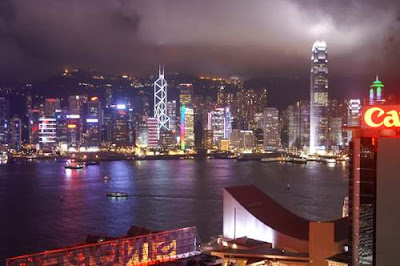 Image of Hong Kong at night. Note the tall IFC2 tower, the super tall skyscraper, on Hong Kong Island.