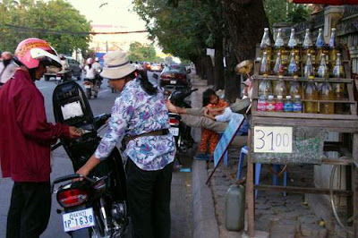 Image of a roadside gas, or petrol, station in Cambodia...