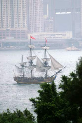 An image of an old frigate in Hong Kong's Victoria Harbour