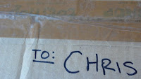 Image of the words 'TO CHRIS' on the package