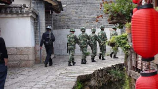 Image of regular People's Liberation Army soldiers going to daily guarding duties in Yunnan Province, China.