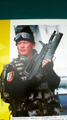 Image of a heavily armed PLA (People's Liberation Army) solider.