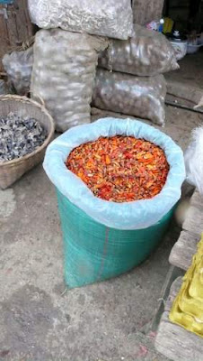 Image of dried chillis for sale in a market in Yunnan Province, China.