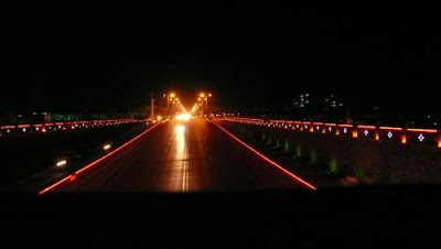 Image of an illuminated highway underpass in Pingyao, Shanxi Province, China.