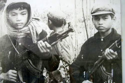 Image of two child Khmer Rouge soldiers taken sometime between 1975 and 1979 in Cambodia.