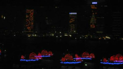Image of an armada of neon-lit 'Chinese Junks' on the water for the opening of the 2009 East Asian Games in Hong Kong