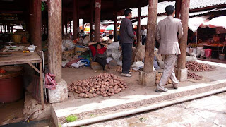 Second image of Chinese workers in a market in Lijiang, Yunnan Province. This image is titled 'Having seen the good life being produced in the factories they toil in, these workers are willing to turn their backs on all, unless they start to get a piece of the good life