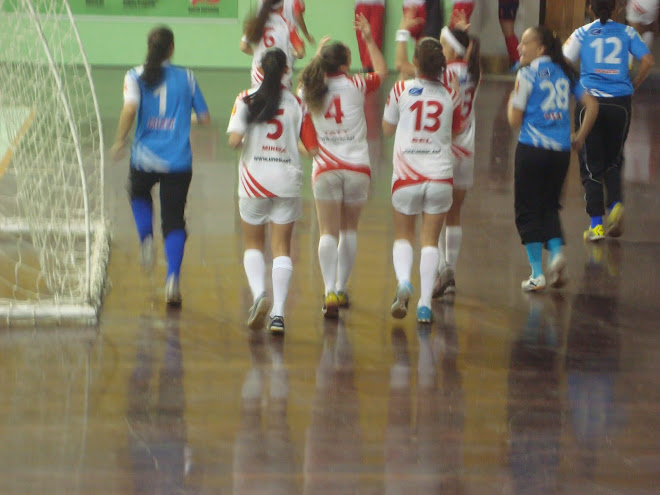 Warming Up before a game: Ponytail is the style in Brazil;s  FIFA Women Futsal