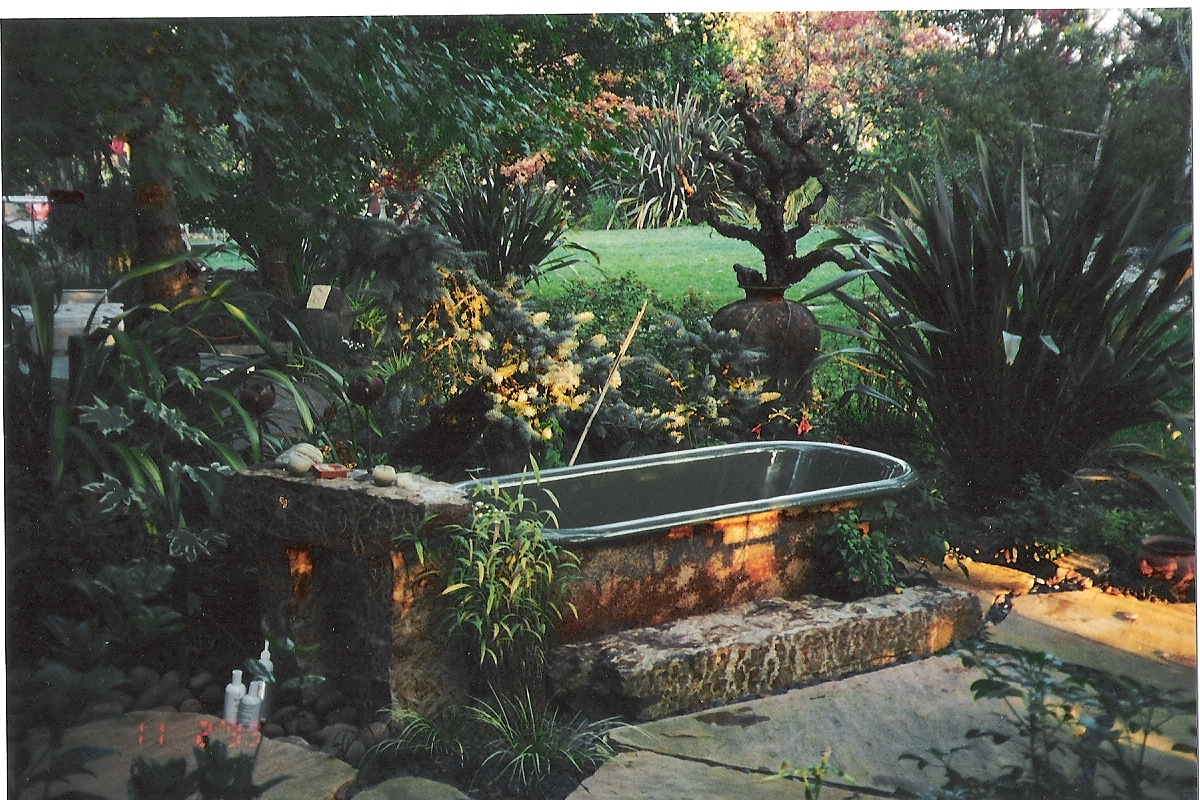Outdoor tubs on pinterest outdoor tub hot tubs and for Outdoor pond tub