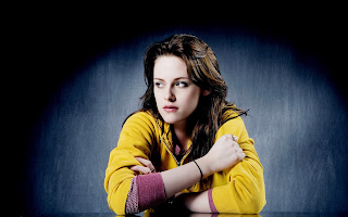Kristen Stewart Sits in Yellow Wallpaper