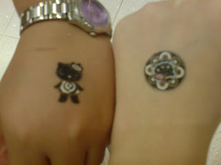 We even got Hello Kitty Tattoos~. Mine's on the right~. But it's gone le.