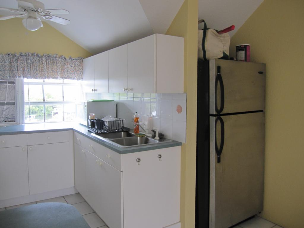 real estate tips kitchen area with white formica cabinets