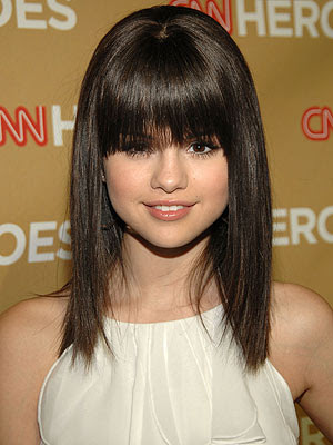 selena gomez with short hair and side bangs. long hair with angs. long