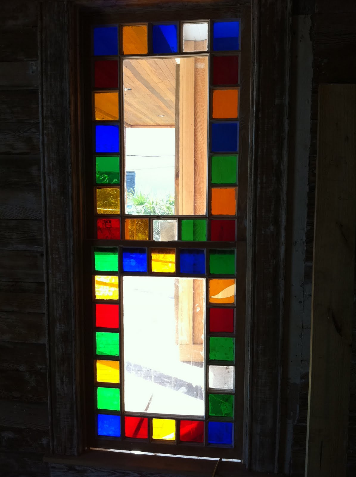 Our three colored glass windows saving the 1868 fulton for Glass windows