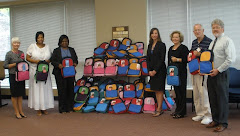Haddaway-Riccio distributes backpacks to local children