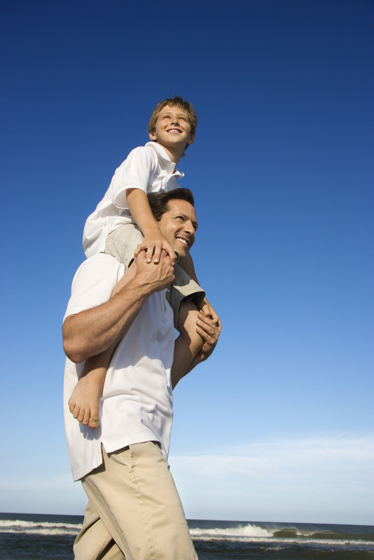 Child On Man's Shoulders