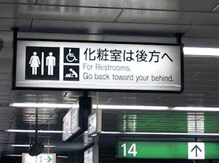 for restrooms go back towards your behind sign