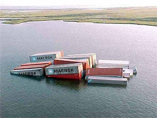 shipping containers sink in flood