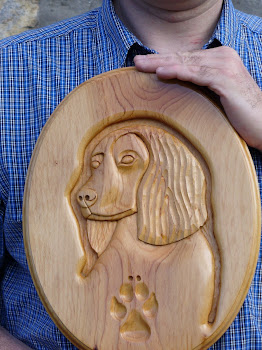 Working cocker spaniel hand carved in cedar.