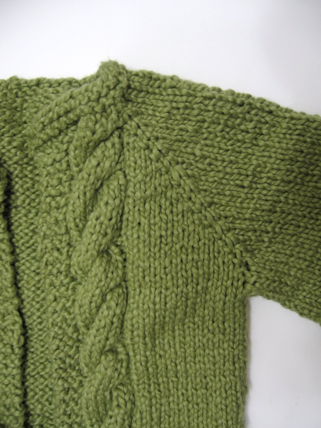 Lula Louise: Green Cabled Baby Cardigan