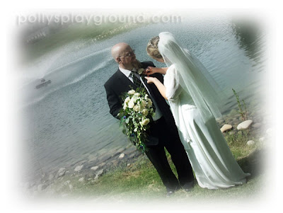bride fixes groom boutonniere