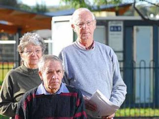pensioners standing outside a toilet