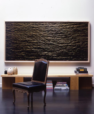A large-scale photographic print by Richard Misrach, 'Untitled 2003', hangs  above a modernist oak bench designed by Steven Volpe. The pair of Baktrian  stone ...