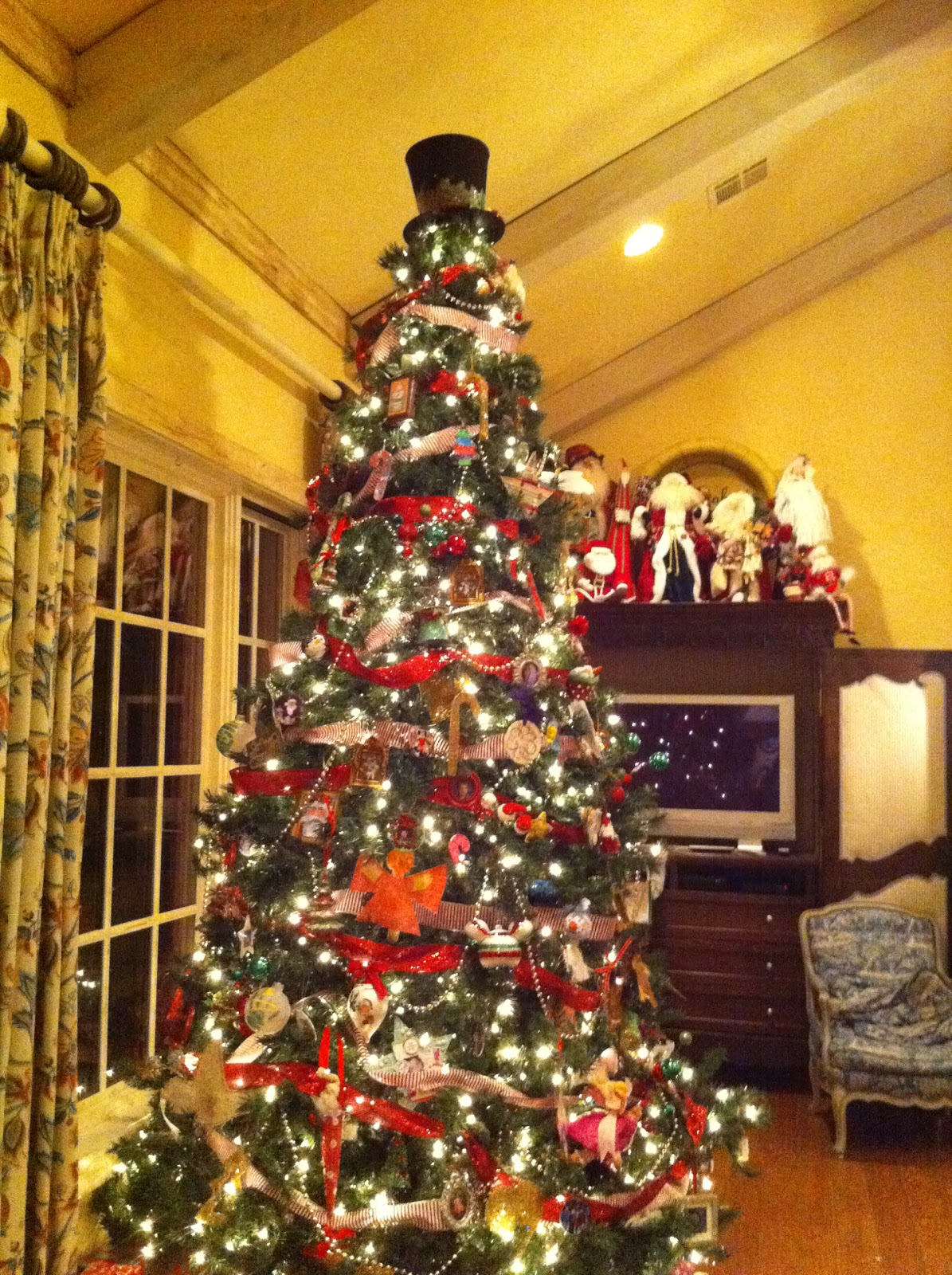 christmas tree in the living room this year it is decorated with all title=