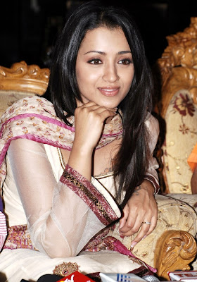 Trisha krishnan looking awesome in white dress unseen pics