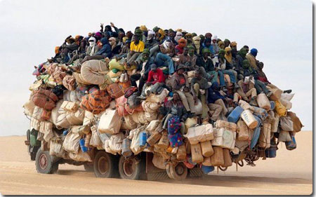 African Truck Covered in People