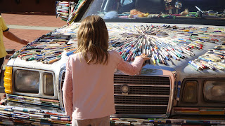 Little Girl Looking at the Hood of the Mercedes Pens In San Rafael