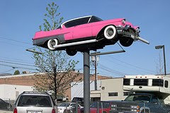 pink cadilac on pole