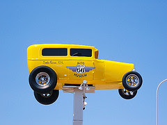 Yellow model T on pole