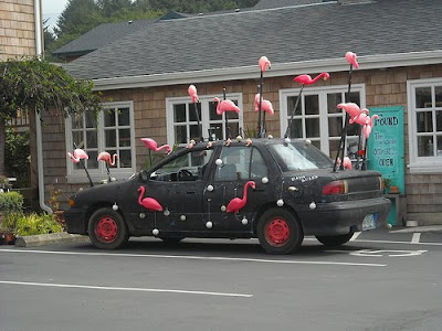 Black Art Car with Flamingos on poles