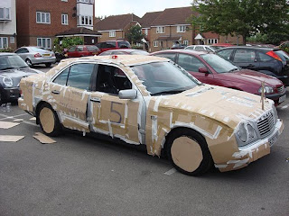 Mercedes Benz Covered in Cardboard
