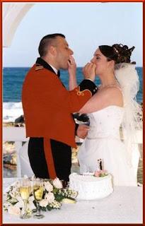 Feeding each other wedding cake