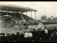 Crowds gather for an auto race at the Elsmere fairgrounds' racetrack in 1919