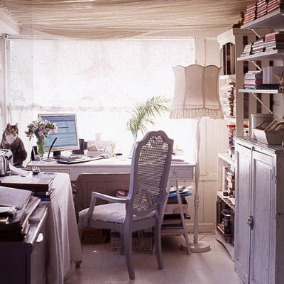 Office-zone-with-beautiful-wooden-furniture-in-vintage-style-and-laminate-flooring